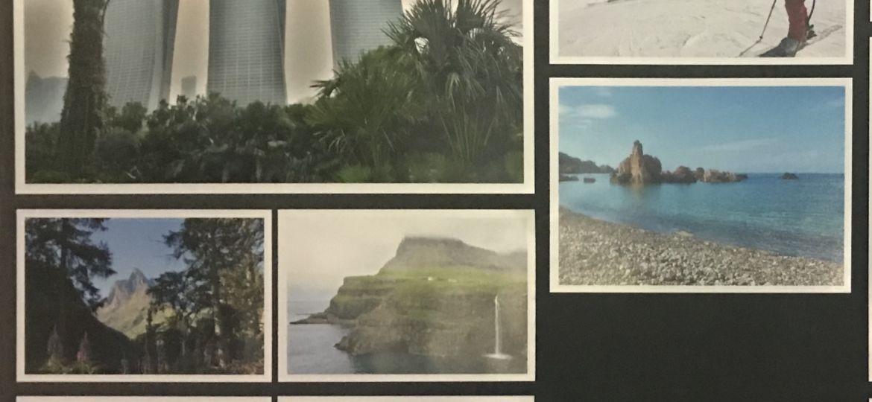 Bilderwand mit aufgeklebten Bildern
